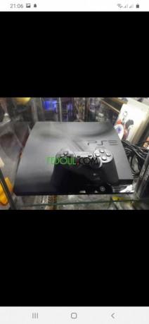 playstation-3-slim-320-giga-flashee-avec-11-dvd-original-ainsi-que-10-jeux-dans-le-disc-dure-big-0