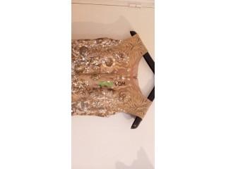 Une magnifique robe de soirée dorée